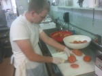 chopping tomatoes @ Mid West food night @ St John Vianney College Seminary, Miami, FL